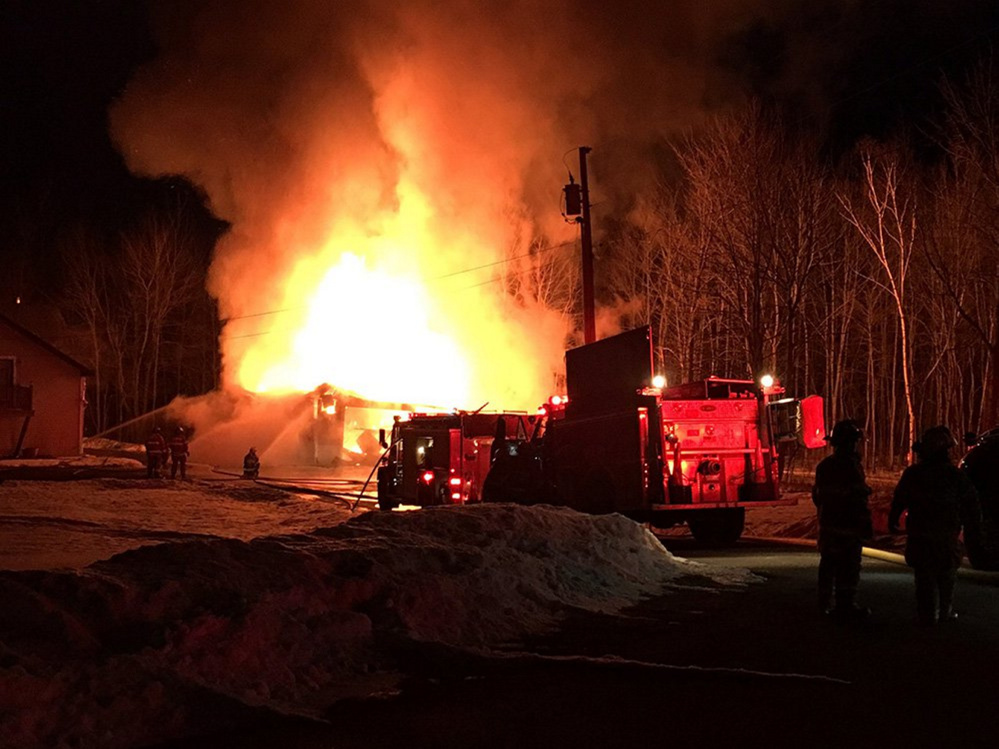 A two-bay garage in Manchester was destroyed by fire Monday night, but firefighters were able to prevent the blaze from spreading to the house on Friendship Drive.