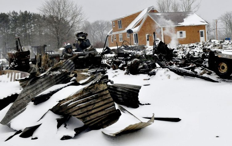 Smoke continues to rise Tuesday from the burned remains of a barn on West Ridge Road in Cornville, which was destroyed by fire the previous evening. A 14-year-old girl living at the residence has been charged with arson in connection with the blaze.
