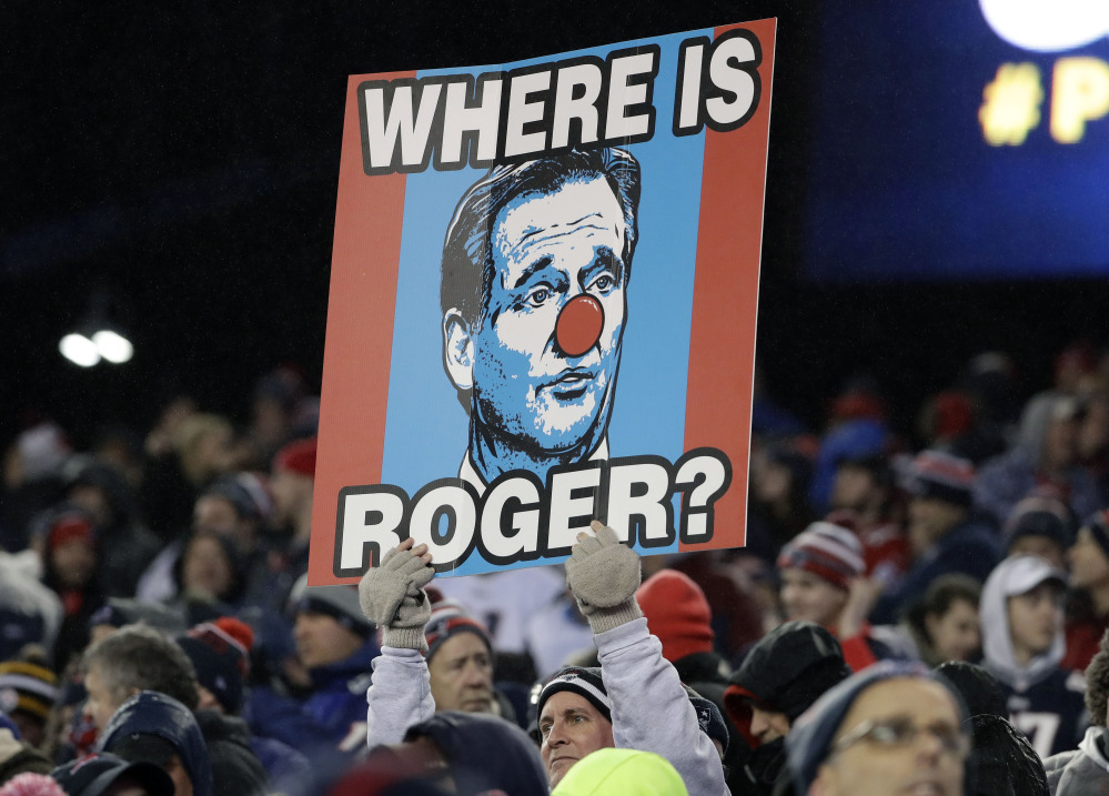 A New England Patriots fan holds a sign referring to NFL commissioner Roger Goodell during the the AFC championship NFL game Sunday in Foxborough, Massachusetts.