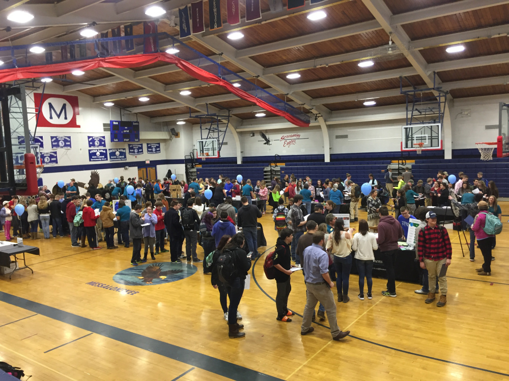 The Messalonskee High School gymnasium is full of students during the Financial Fitness Fair 2017.