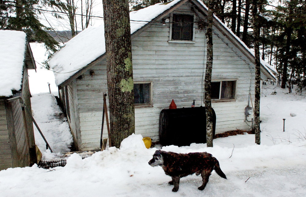 This pet dog named Pee-wee, owned by Richard and Leonette Sukeforth, remained vigilant outside their former home on Lovejoy Pond in Albion on Jan. 4. The Sukeforths, who now reside in Holden with their daughter, were recently evicted from their home after nonpayment of taxes.