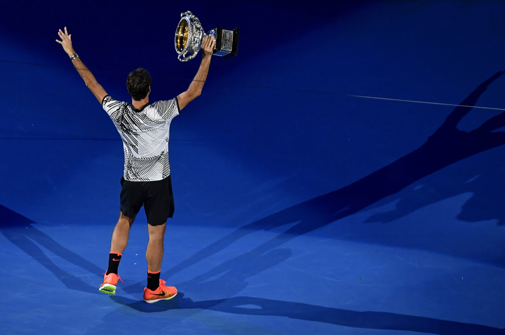 Roger Federer holds his trophy after defeating Rafael Nadal during the men's singles final at the Australian Open on Sunday in Melbourne, Australia.