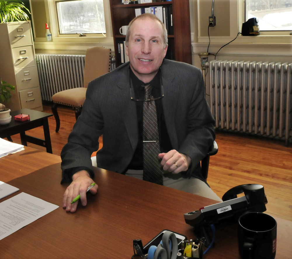 Seated at the Regional School Unit 18 Central Office in Oakland on Monday, Carl Gartley will be the new superintendent for the school district beginning this July.