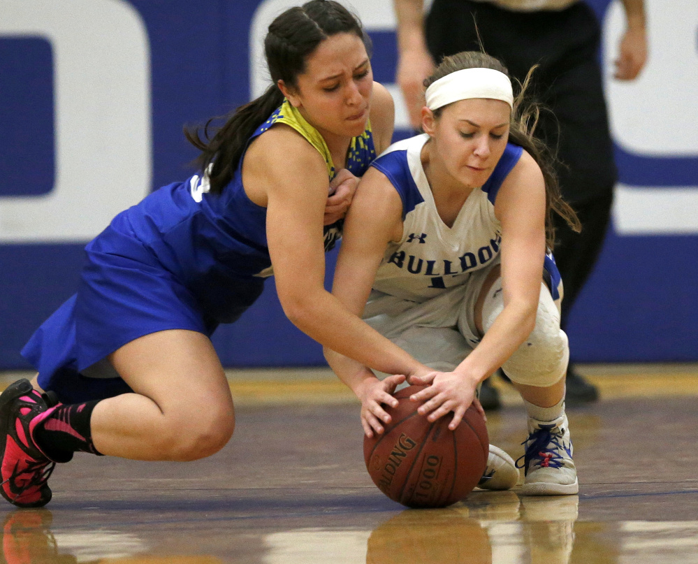 Mt Abram sophomore, left, Summer Ross and Madison junior Sydney LeBlanc fight for possession of the ball during the first half of a Mountain Valley Conference game Tuesday night.