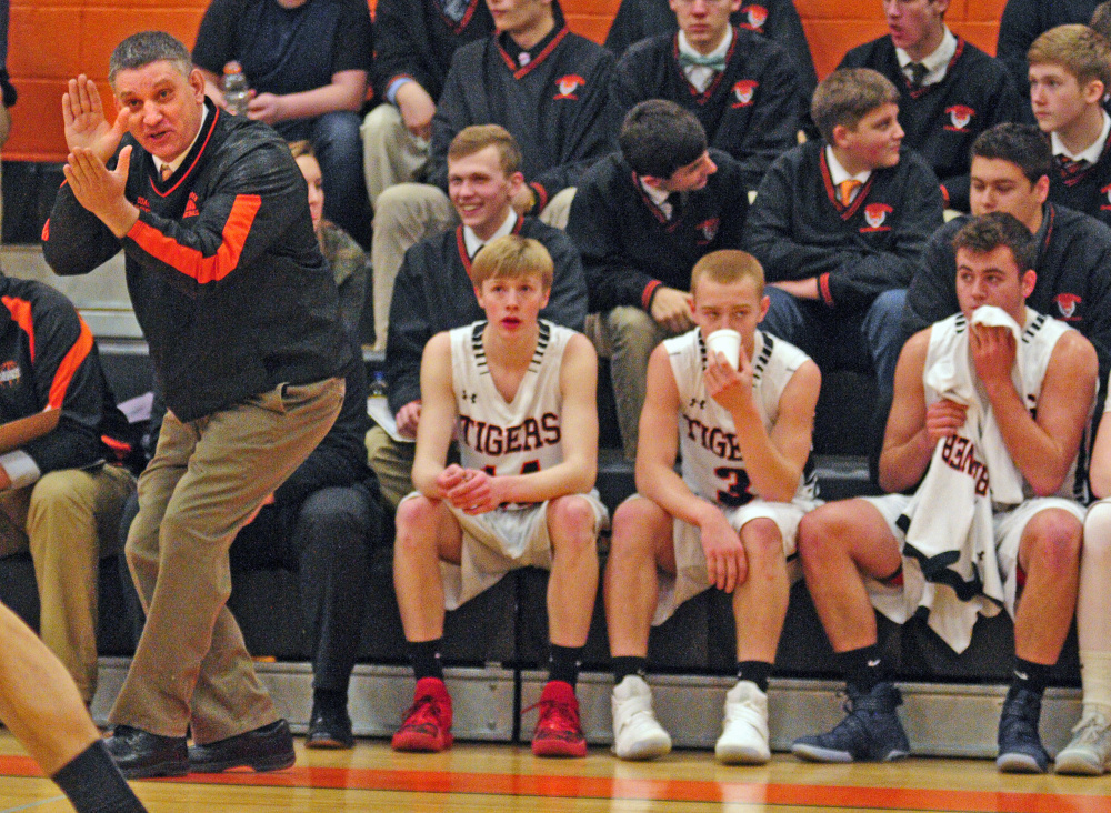 Staff photo by Joe Phelan   Charlie Lawrence coaches the Tigers during a game against Hampden on Tuesday in Gardiner.