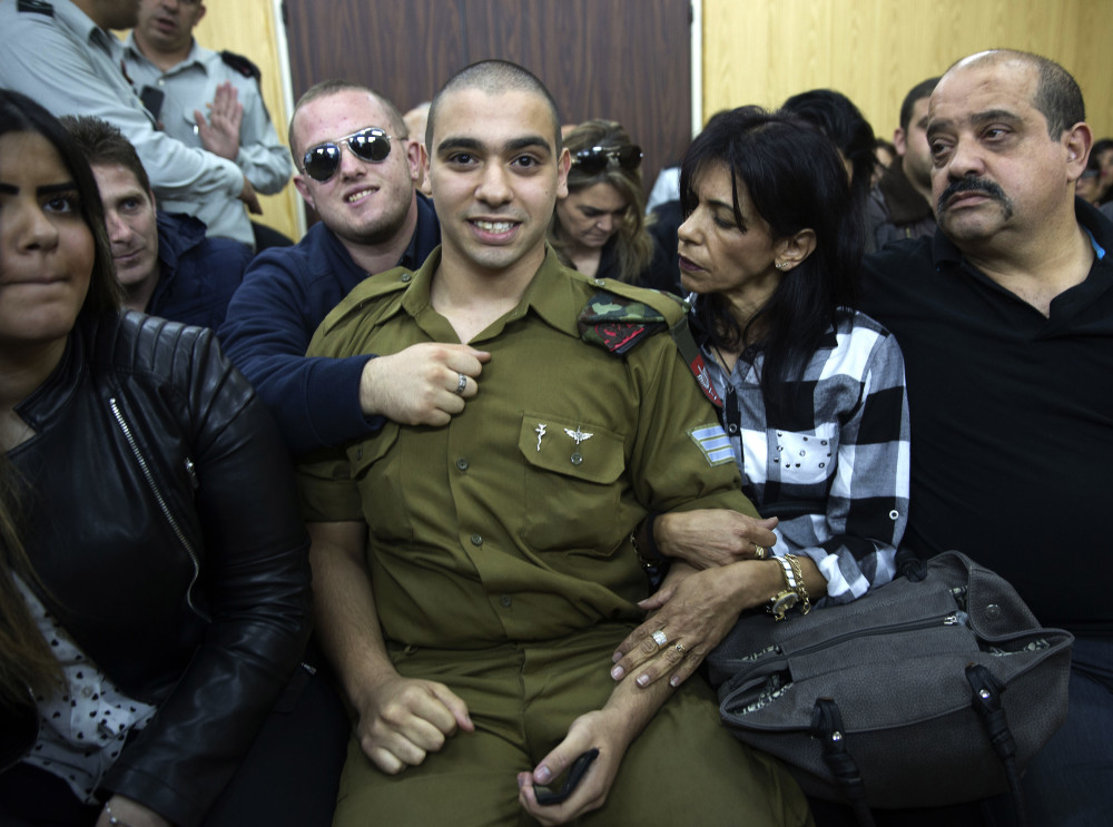 Israeli soldier Sgt. Elor Azaria waits with his parents for the verdict inside the military court in Tel Aviv on Wednesday <em>Heidi Levine via AP</em>