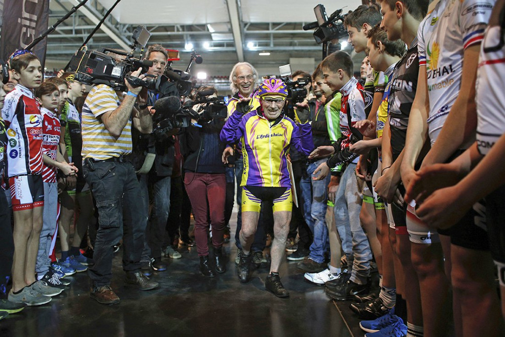 Robert Marchand, 105, arrives to begin his bid to beat his record for distance cycled in one hour, at the velodrome of Saint-Quentin en Yvelines, outside Paris, Wednesday. <em> Associated Press/Thibault Camus</em>
