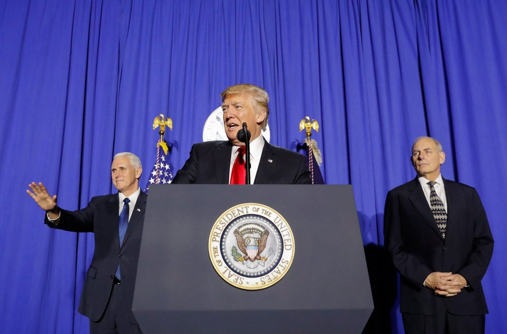 President Trump, accompanied by Vice President Mike Pence, left, and Homeland Security Secretary John F. Kelly, speaks at the Homeland Security Department in Washington on Wednesday.