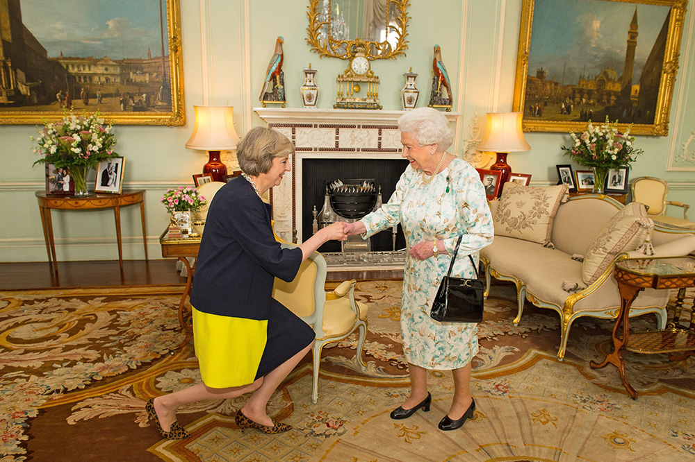 Queen Elizabeth II welcomes Theresa May at the start of an audience in Buckingham Palace, where she invited the former home secretary to become prime minister and form a new government. May last week invited President Trump for a state visit, putting the Queen in an awkward position.