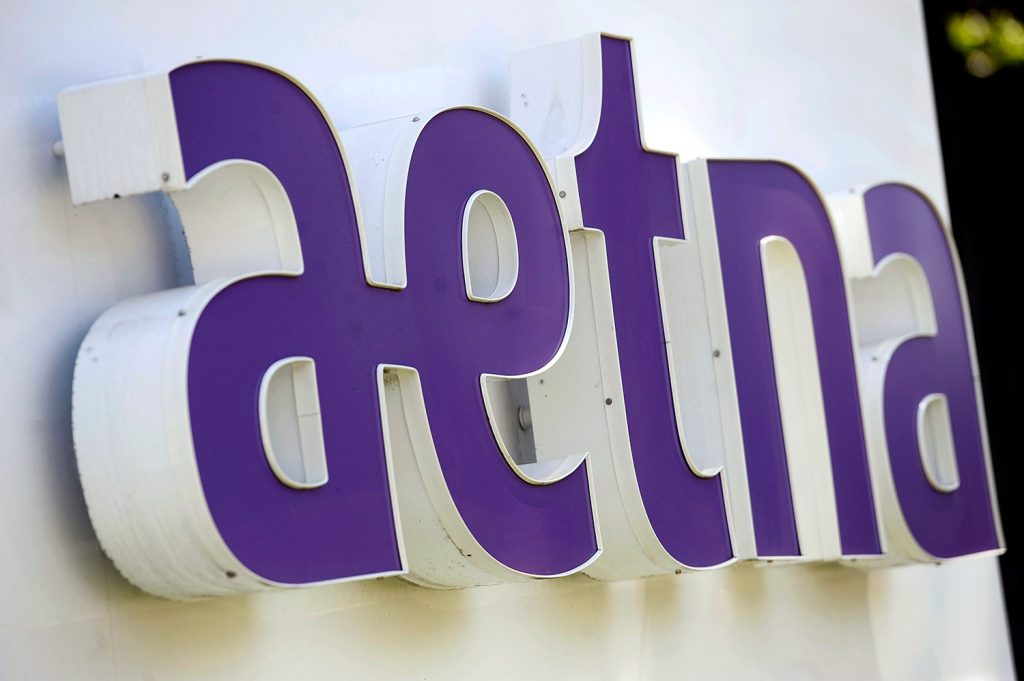 A federal judge has rejected health insurer Aetna's plan to buy rival Humana for about $34 billion and become a major player in the market for Medicare Advantage coverage.