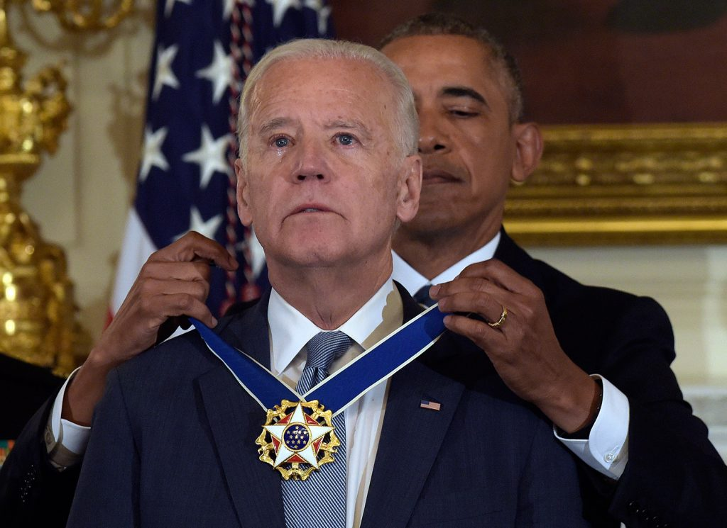 President Barack Obama presents Vice President Joe Biden with the Presidential Medal of Freedom during a ceremony in the State Dining Room of the White House in Washington on Thursday. The award caught Biden by surprise.