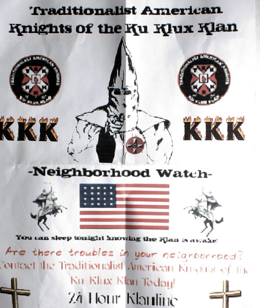 "This Ku Klux Klan flier, which was originally folded into a sandwich bag, weighted with pebbles and left at the end of a driveway on South Freeport Road, is one of about two dozen such fliers found by Freeport and Augusta residents recently. Identical flyers also were found in Waterville on Monday morning. The crudely printed flier reads, ""You can sleep tonight knowing the Klan is awake. ... Are there troubles in your neighborhood? Contact the Traditionalist American Knights of the Ku Klux Klan Today!"""