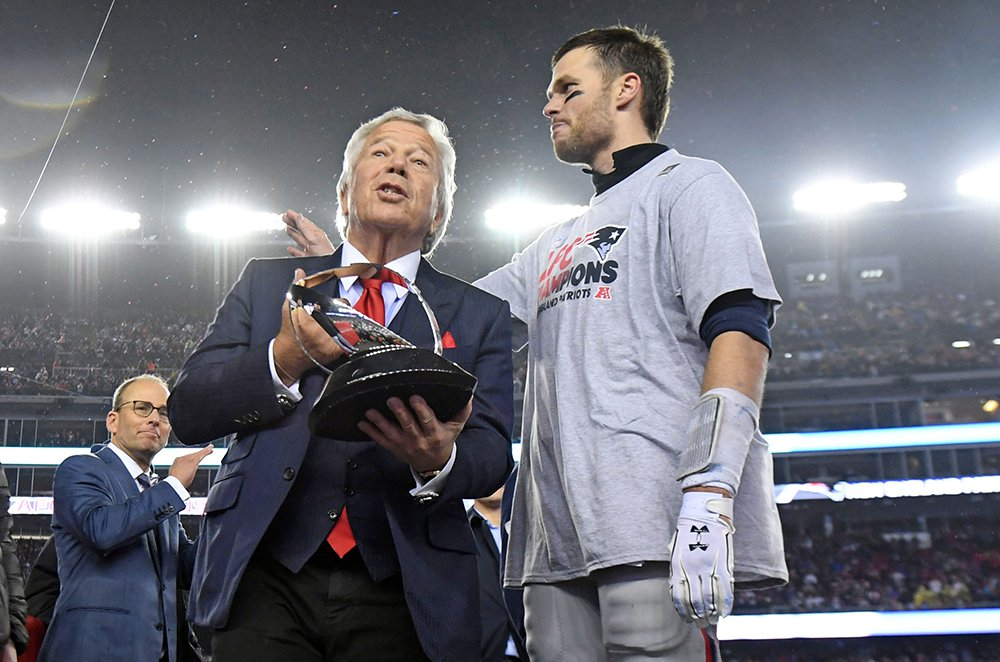 New England Patriots owner Robert Kraft and quarterback Tom Brady with the Lamar Hunt Trophy after beating the Pittsburgh Steelers Sunday in the 2017 AFC Championship Game at Gillette Stadium. Brady has repeatedly to signed contracts or restructured  them to give the Patriots flexibility to sign other players.