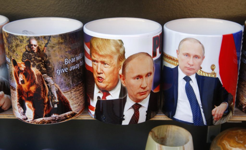 Cups depicting Russian President Vladimir Putin and President Trump for sale in St. Petersburg, Russia. The two leaders are set to talk Saturday.