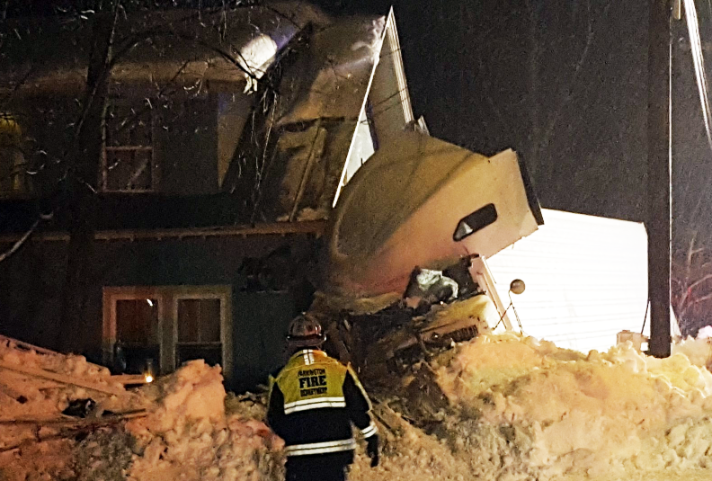 Part of Route 4 in Farmington was closed Tuesday night after a tractor-trailer slid off icy pavement and hit a house.