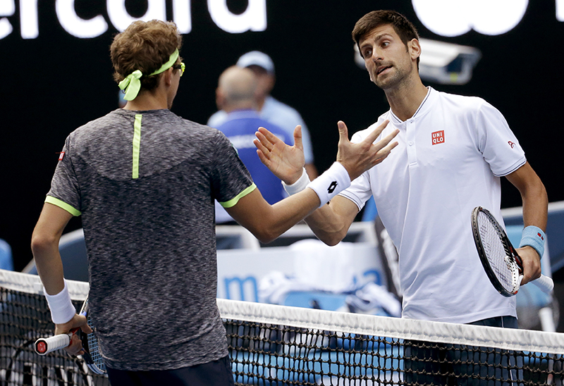 Serbia's Novak Djokovic, right, congratulates Uzbekistan's Denis Istomin after winning their second round match.