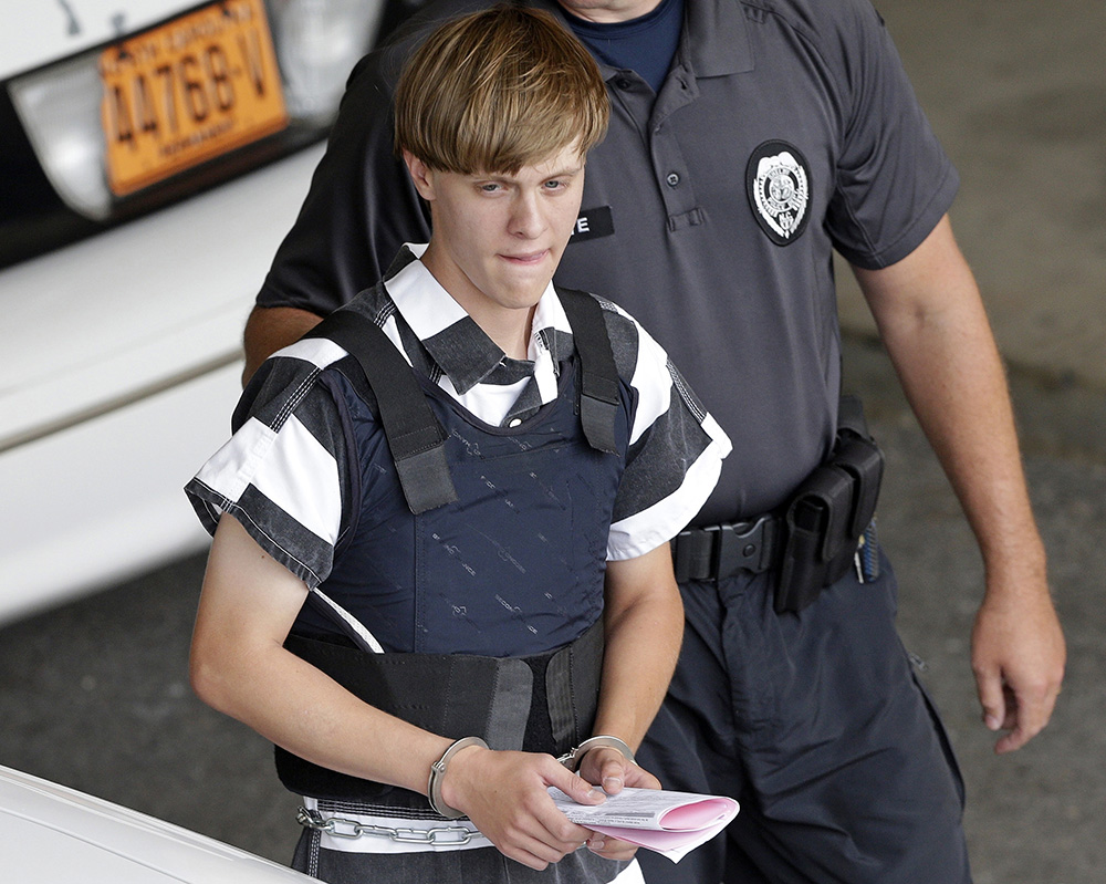 Dylann Roof is escorted from the Cleveland County Courthouse in Shelby, N.C., on June 18, 2015. The sentencing phase of Roof's federal trial began Wednesday in Charleston. He could face the death penalty or life in prison. <em>Associated Press/Chuck Burton</em>