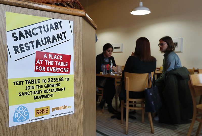 A sanctuary restaurant sign is shown inside Russell Street Deli in Detroit.