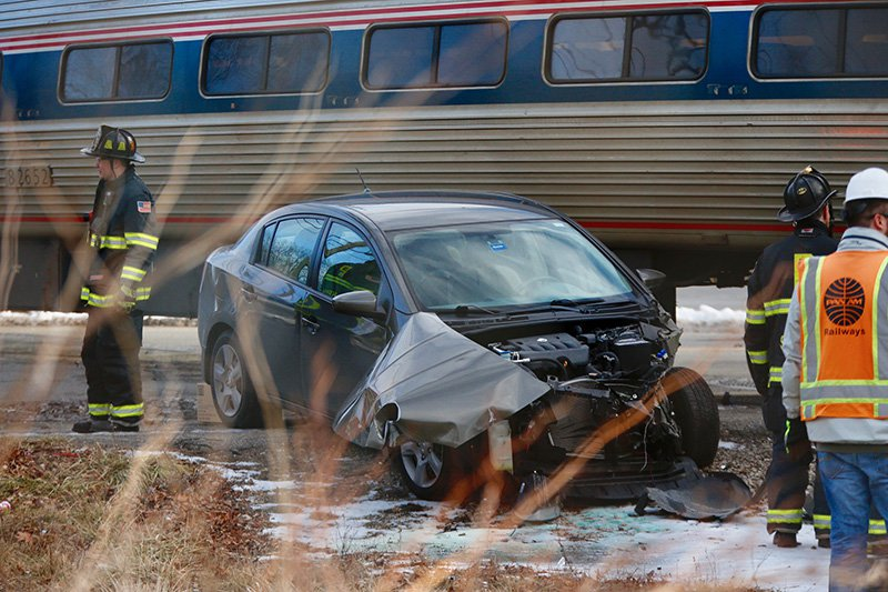 Police have charged the driver of this that was hit by a Downeaster train Friday at the crossing on Brighton Avenue near St. John Street.