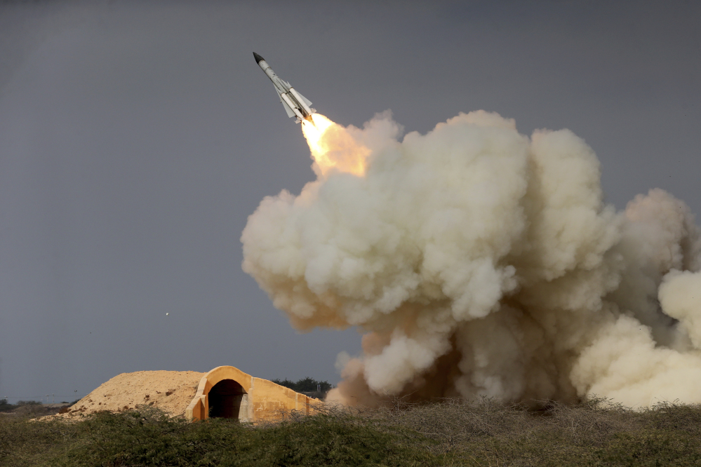 A long-range S-200 missile is fired in a military drill in the port city of Bushehr, on the northern coast of the Persian Gulf in Iran in December 2016. Iran has test-fired various ballistic missiles since the July 2015 nuclear deal with world powers. Iran says they don't violate any strictures because they aren't designed to carry nuclear warheads.