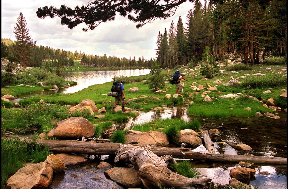 Backpackers enter Sallie Keyes Lakes from Selden Pass along the John Muir Trail. A new study suggests that a couple days of camping in the great outdoors can reset your circadian clock and help you get more sleep.