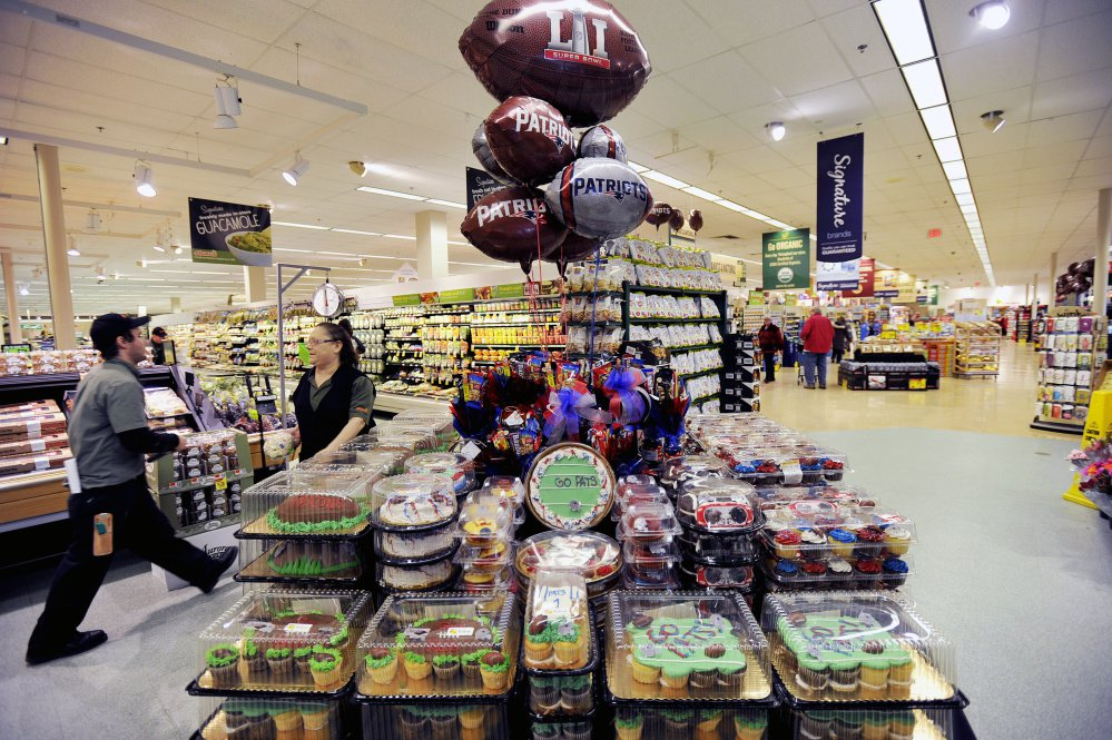 Snacks and Patriots' balloons are on display at Shaw's in Falmouth.