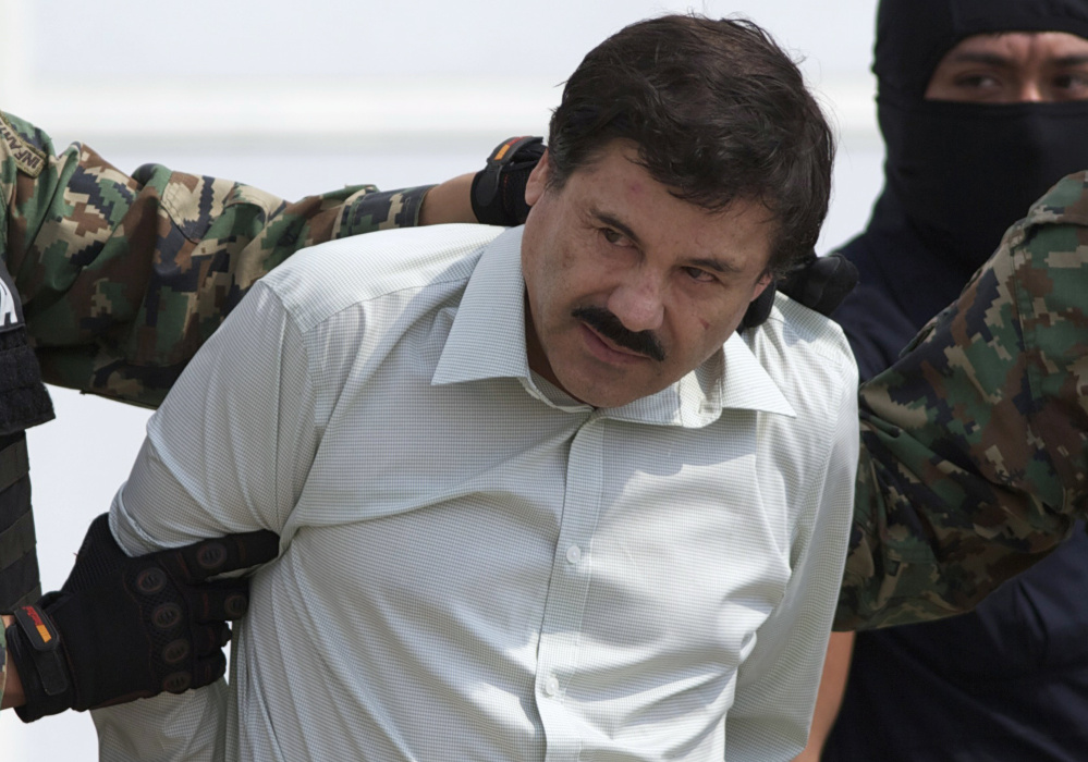 "Joaquin ""El Chapo"" Guzman, the leader of the Sinaloa cartel, is escorted to a helicopter in Mexico City after his capture in Mazatlan in 2014. Associated Press/Eduardo Verdugo"