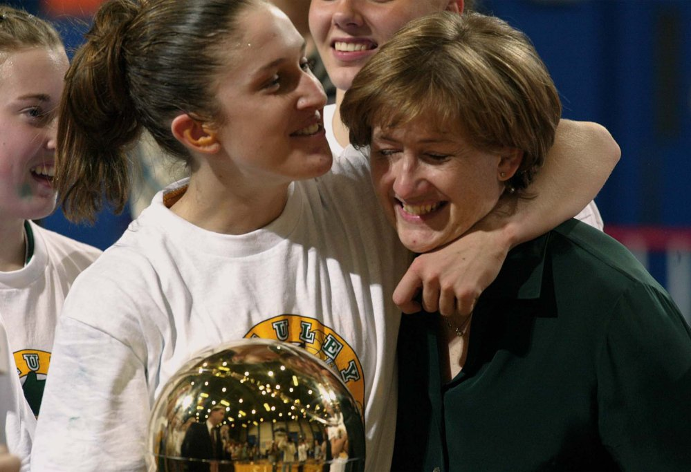 Staff photo Number 3 Sarah Marshall and Coach Elizabeth Rickett with gold ball celebration after winning state class A champ.