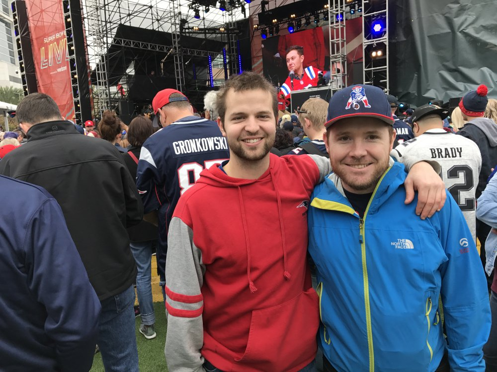 Shane Spink, left, of Eliot and Ashton Depasquale of York, both nuclear engineers at Portsmouth Naval Shipyard, attend the rally where country singer Scotty McCreery performed Saturday.