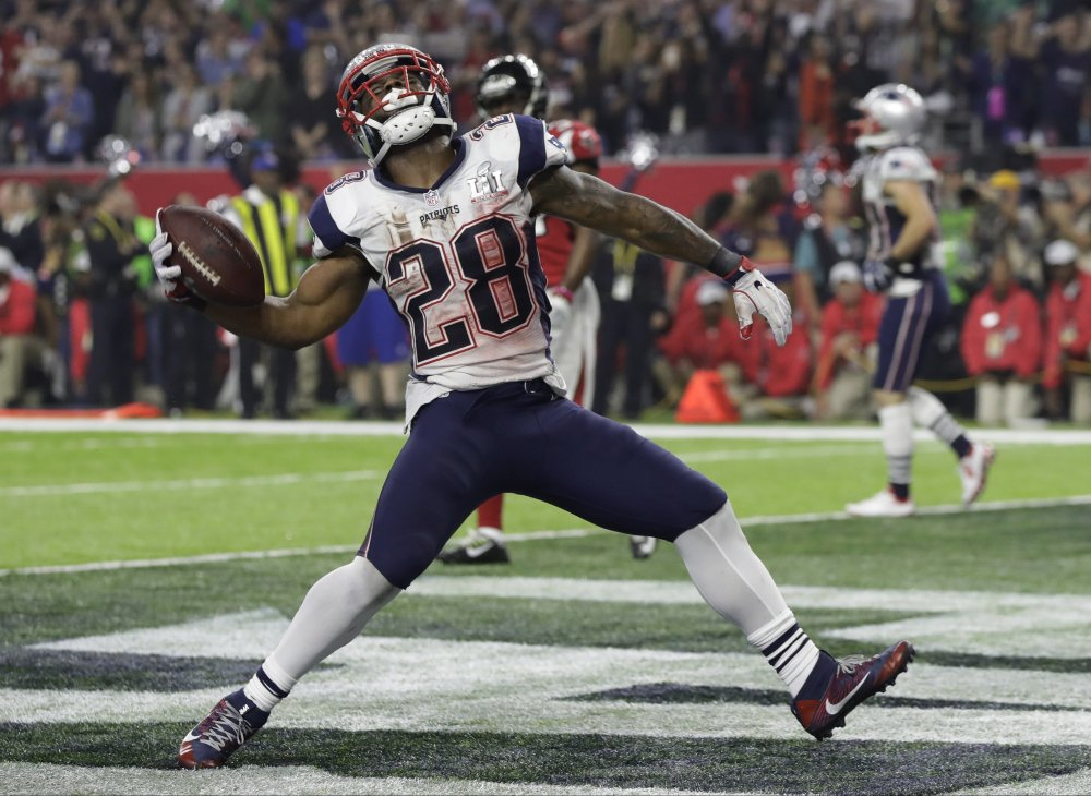 New England Patriots' James White celebrates after scoring a touchdown during the second half of the Super Bowl.