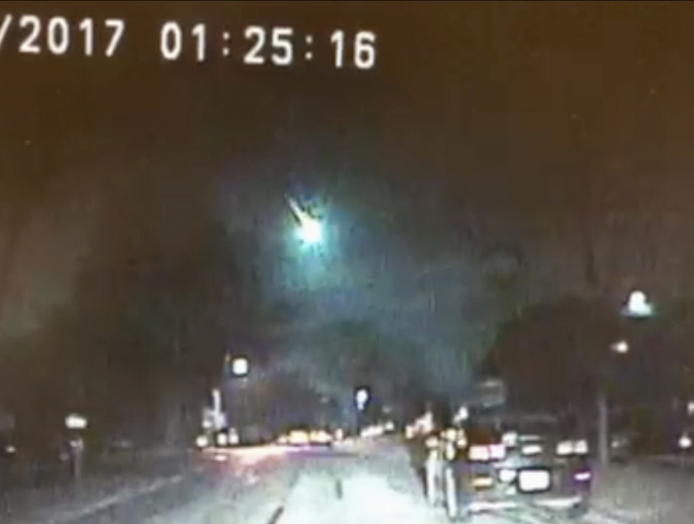 Dashcam video image provided by police in Lisle, Ill., shows a meteor as it streaked over Lake Michigan early Monday. The meteor lit up the sky across several states in the Midwest.