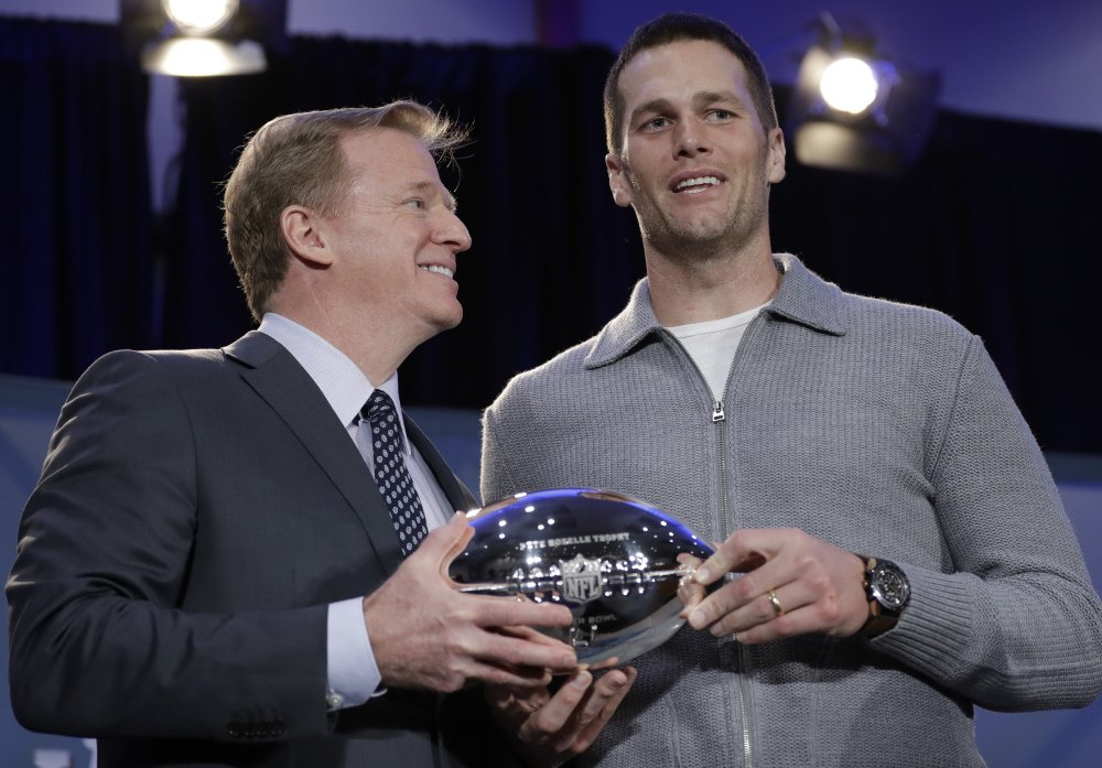 Patriots fans were looking forward to this moment, when NFL Commissioner Roger Goodell, left, handed Tom Brady the Super Bowl MVP trophy. Goodell suspended Brady for four games to start the season, yet the two were cordial in their meeting Monday.