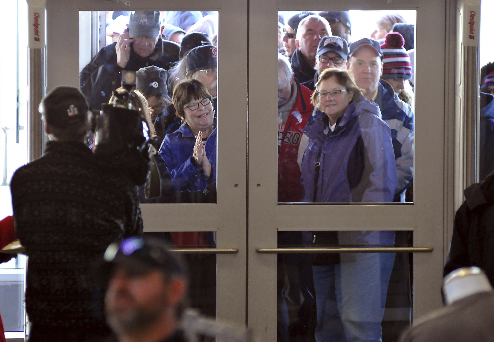 New England Patriots fans wait to get into the Pro Shop at Gillette Stadium in Foxborough, Mass., Monday, Feb. 6, 2017. The shop opened at 6 a.m. the morning after the Patriots defeated the Atlanta Falcons in Super Bowl LI. (Mark Stockwell/The Sun Chronicle via AP)