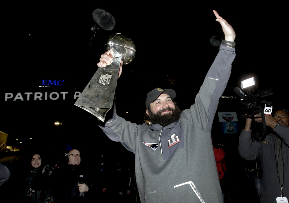New England Patriots defensive coordinator Matt Patricia raises the Super Bowl trophy following the team's arrival at Gillette Stadium, Monday, Feb. 6, 2017, in Foxborough, Mass., after defeating the Atlanta Falcons 34-28 Sunday in the NFL Super Bowl 51 football game in Houston. (AP Photo/Steven Senne)