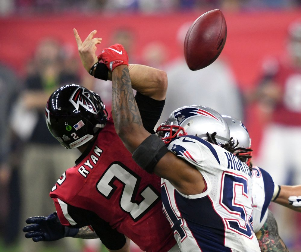 Patriots linebacker Dont'a Hightower sacks Falcons quarterback Matt Ryan, causing a crucial late-game fumble that set up a New England touchdown.