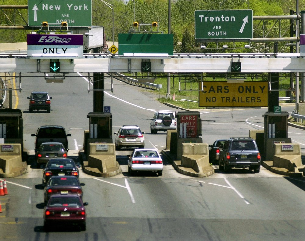 Cars pass through toll lanes as they enter the New Jersey Turnpike at Exit 9 in East Brunswick, N.J. Most drivers grudgingly pay tolls on bridges and highways but some go to great lengths to avoid them.