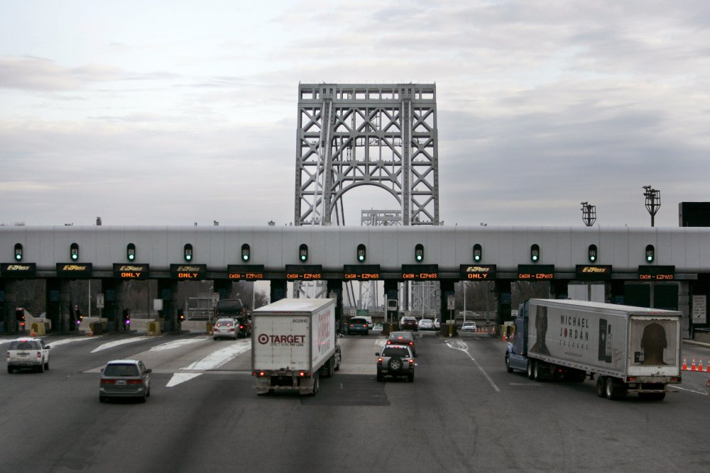 Trucks approach the toll booth at the George Washington bridge in Fort Lee, N.J. Many of those drivers have racked up thousands of dollars in unpaid tolls and related fees that can lead to theft and other criminal charges.