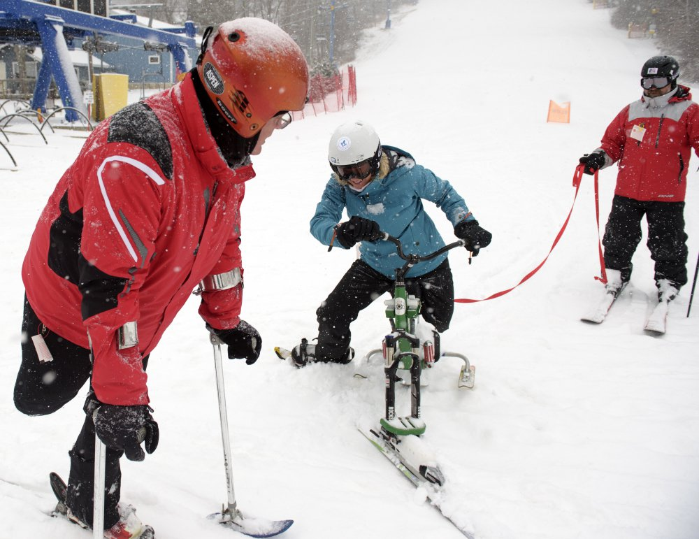 Connecticut state Senator Ted Kennedy, Jr., left,  goes down the slopes with Julie Carman and Bert Van de Weerdt, right. Kennedy, who lost a leg to bone cancer as a 12-year-old, visited with LOF Adaptive Skiers who were offering lessons.