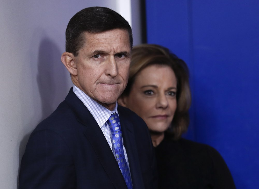 National Security Adviser Michael Flynn stands with K.T. McFarland, deputy national security adviser, at a news briefing at the White House this month. He resigned Monday night amid controversy over his discussions with a Russian ambassador.