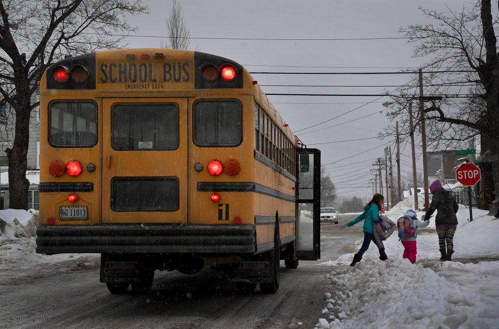A school bus lets children off early as a snowstorm approaches in East Millinocket.