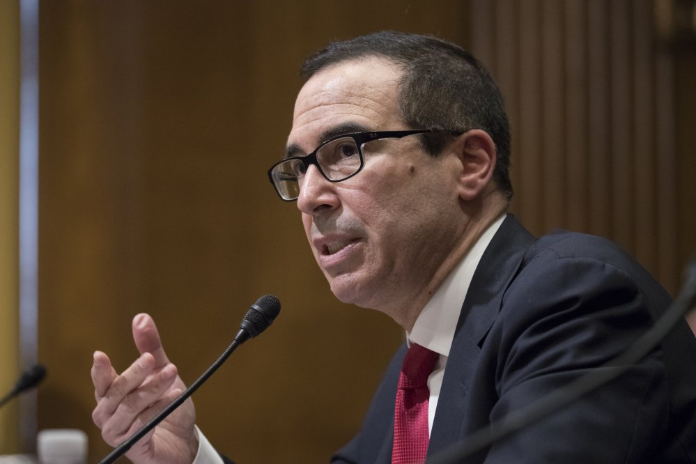 Steven Mnuchin testifies at his confirmation hearing Jan. 19 before the Senate Finance Committee. Mnuchin was confirmed by the Senate as treasury secretary on Monday evening.