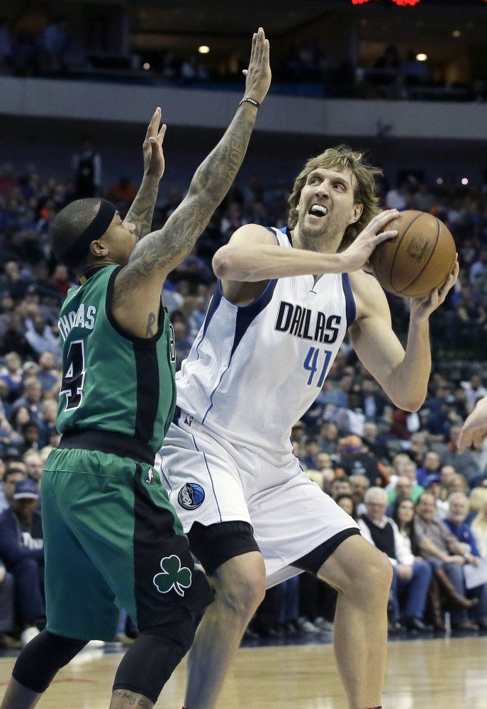 Mavericks forward Dirk Nowitzki, with a big height advantage, looks to shoot against Isaiah Thomas in the first half of Monday night's game in Dallas.