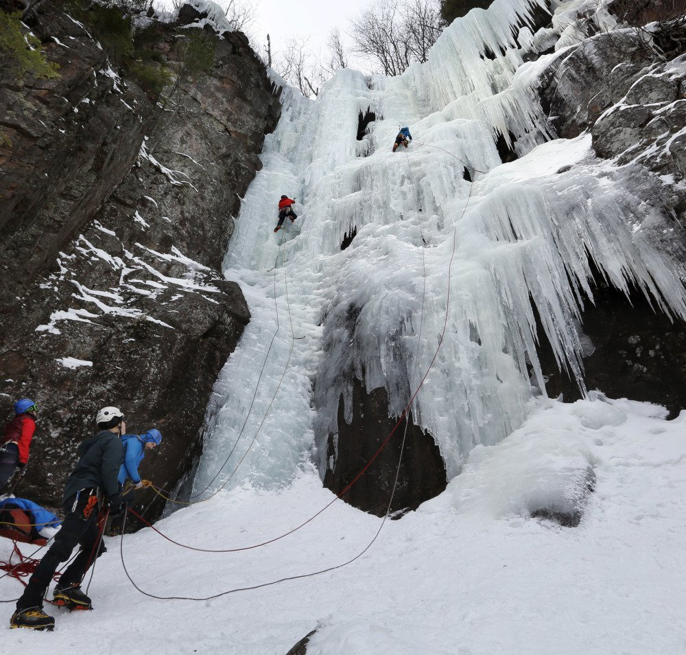 "Two climbers ascend Frankenstein Cliff's ""Dracula"" on Feb. 6. Ice climbing presents puzzle-solving challenges that appeal to engineers like himself, Monjak says."