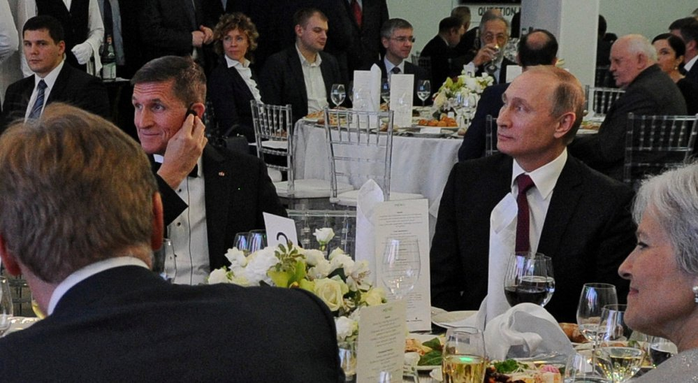 Russian President Vladimir Putin, right, sits next to Flynn at an event in Moscow in 2015. Flynn misled administration officials in denying he had discussed U.S. sanctions with a Russian envoy.