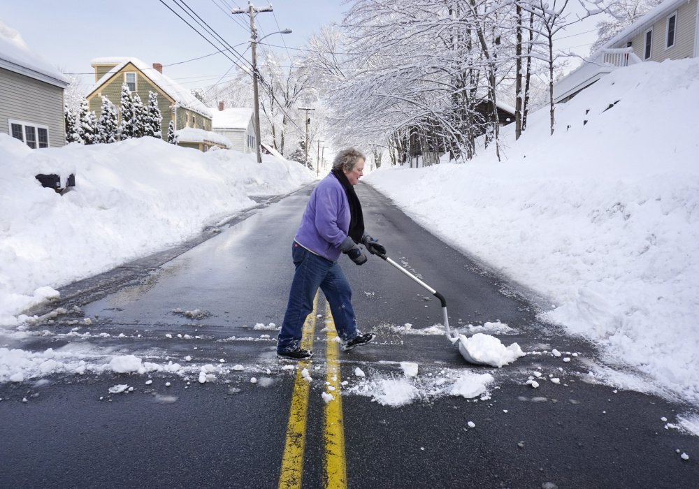 SOUTH BERWICK, ME - FEBRUARY 16: Claire Curtis pushes snow across Old Fields Road in South Berwick on Thursday, February 16, 2017. Some residents along Old Fields Road lost power but Curtis says she never lost her power. (/Staff Photographer) KENNEBUNK, ME - FEBRUARY 16: A stop sign in Kennebunk is coated in wet snow on Thursday morning, February 16, 2016. Stop is what many Mainers may be thinking this morning as they wake up to another day of digging themselves out from more snow that fell overnight. (Staff Photo by Gregory Rec/Staff Photographer)