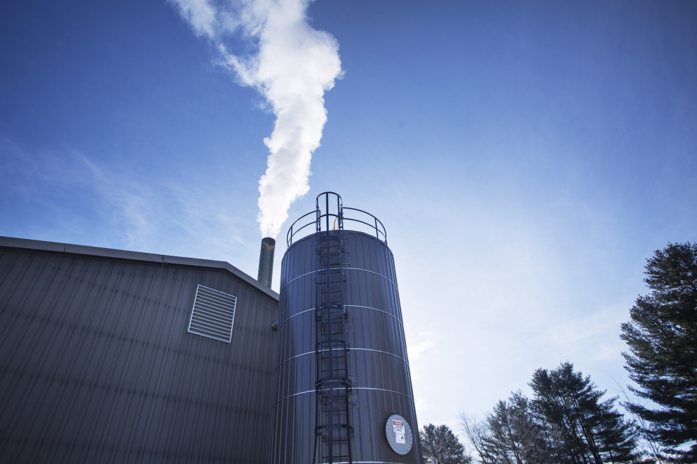 Boiler exhaust rises from a smokestack at Bates College in Lewiston. The school is using wood-derived fuel from Ensyn Corp. in Canada to heat 70 percent of campus buildings. Delivery trucks fill its 20,000-gallon fuel tank five or six times a week.