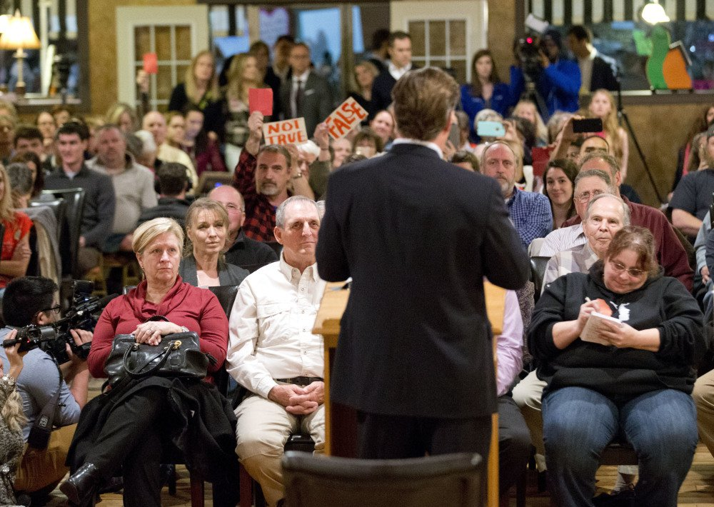U.S. Rep. Dave Brat, R-Va., with his back to the camera, answers questions during a town hall meeting with constituents in Blackstone, Va., on Tuesday.