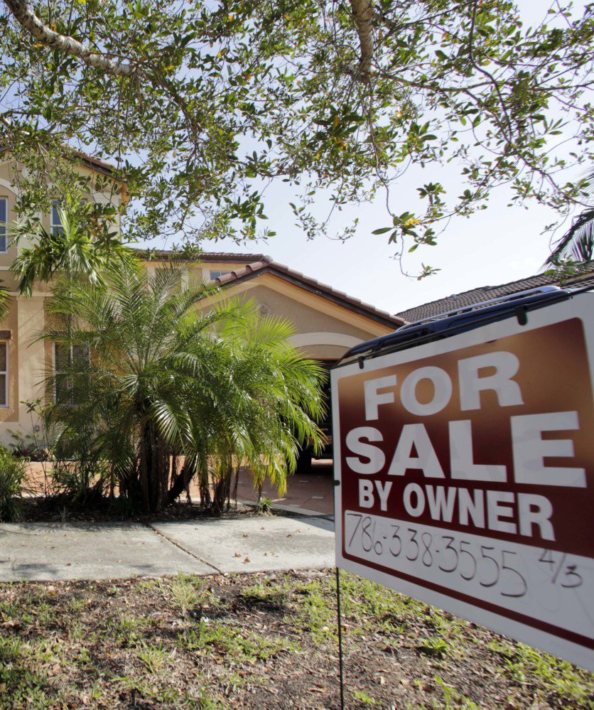 This Dec. 7, 2016 file photo shows a house for sale, in Hialeah, Fla.  Americans shrugged off rising mortgage rates and bought existing homes in January 2017 at the fastest pace since 2007. The National Association of Realtors on Wednesday, Feb. 22, 2017, says home sales rose 3.3 percent last months from December to a seasonally adjusted annual rate of 5.69 million. (AP File)