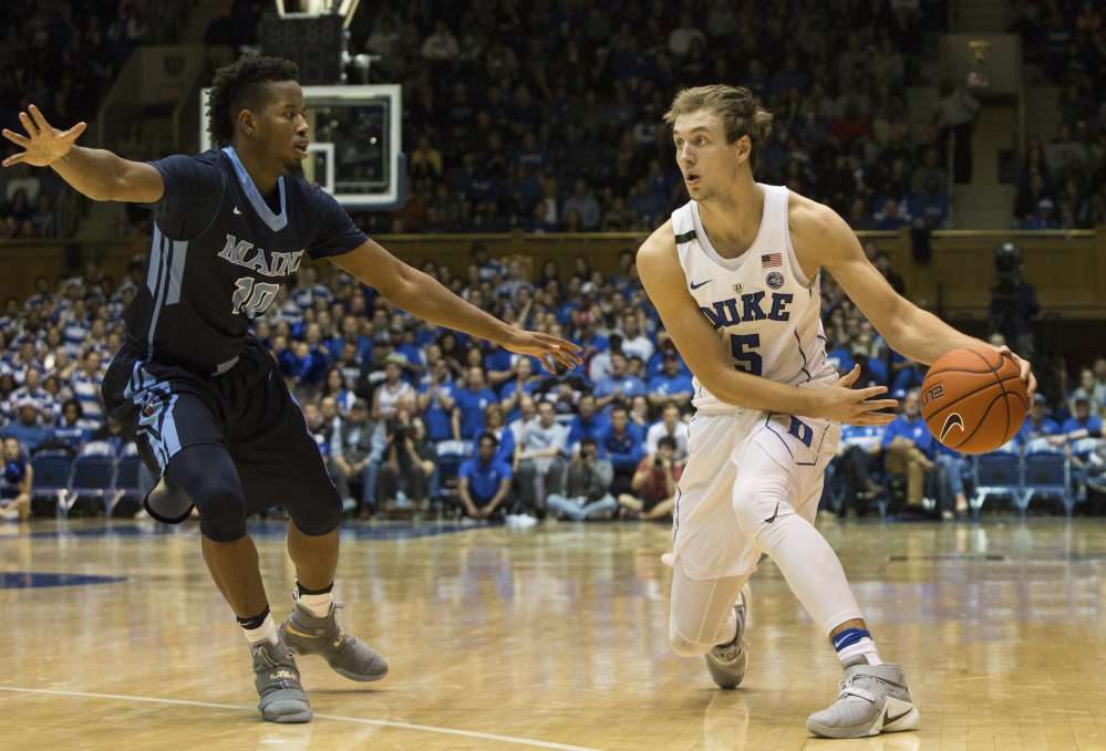 Wes Myers, left, playing earlier this season against Duke, has been suspended indefinitely from the University of Maine men's basketball team after breaking a teammate's jaw.