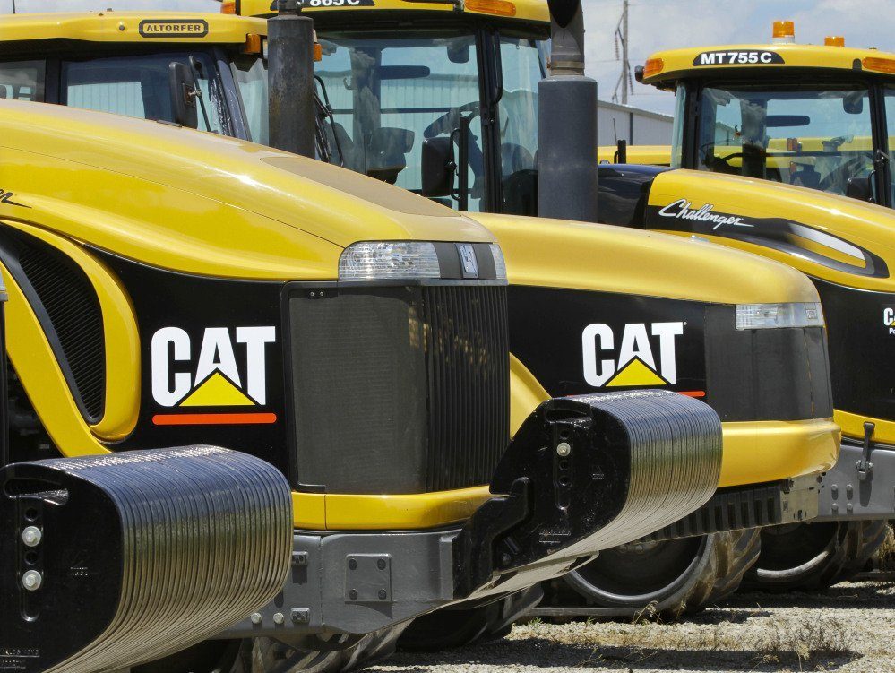 Caterpillar Inc., based in Peoria, Ill., makes earth-moving equipment like these tractors on a lot in Clinton, Ill. The company's recent decision to move 300 top headquarters jobs to the Chicago area left Peoria with a vacuum to fill.